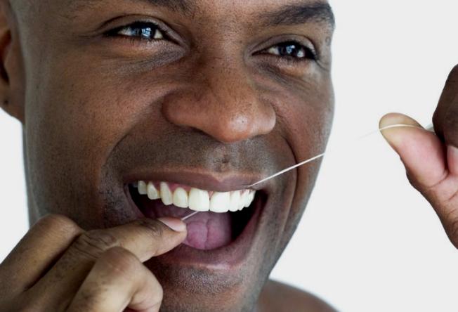 121012-health-rewind-teeth-floss-flossing-dental-dentist
